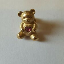 A beautiful gold tone teddy lapel brooch signed by Avon.