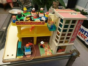 Vintage Fisher Price Play Family Action Garage with 7 cars & figures (& dog)