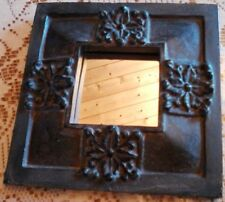 Ancient looking mirror composite that resembles stone