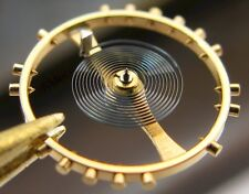 IWC 85 Watch movement part: complete balance wheel #721
