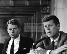 SENATOR JOHN F. KENNEDY WITH BROTHER ROBERT BOBBY IN 1957 - 8X10 PHOTO (OP-813)