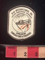 H & R INTERNATIONAL INC. Advertising Patch WORLDWIDE CONSULTING & TRAINING 79T3