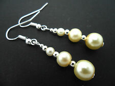 A PAIR OF DANGLY IVORY COLOUR GLASS PEARL  SILVER PLATED    EARRINGS.
