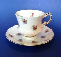 Elizabethan Pedestal Tea Cup And Saucer - Tiny Red Chintz Roses - England