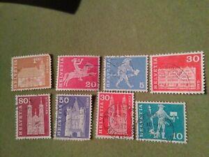 "8 Francobolli Svizzera Helvetia (serie ""Messaggeri e edifici storici"" 1960)"