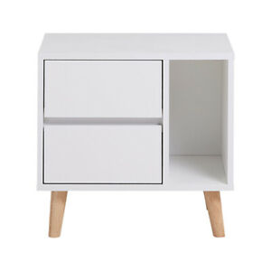 White Bedside Table With Two Storage Drawers Supported By Wooden Legs Nightstand