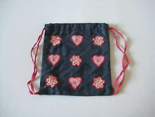 Accessorize Angels small drawstring denim bag with flower and heart appliqué.