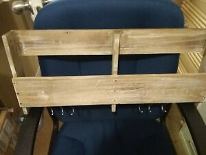 Wood wall hanging storage shelf. Has rod on bottom w/hooks. Cookbooks/pot holder