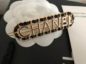 Chanel Beaute Vip Gift Haarspange schwarz-gold Leder