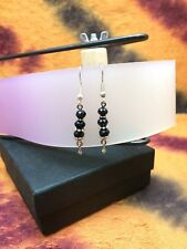 Earrings in silver wire with small tibetan stones, and black crystals