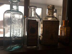 Lot of 4 nice old medicine bottles. Slocums, Simpson Bro's,Bovox & Royal bay rum