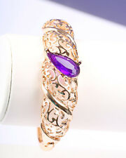 Gold Tone Bracelet with Purple Stone