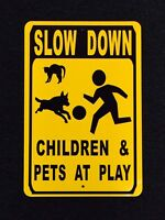 Slow Down Children and Pets at Play 12 by 18 inch Metal Sign
