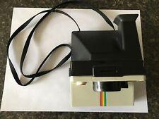 Polaroid One Step camera, with vinyl case