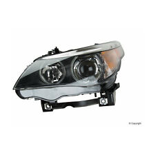 One New Hella Headlight Assembly Front Left H11077031 63127160157 for BMW