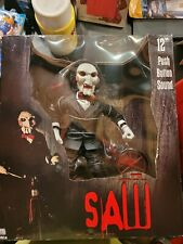"""NECA Saw Billy the Puppet 12"""" figure in box."""