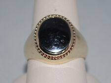 10k Gold ring with a Black Onyx weighs 8.8 Grams