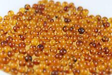 Natural Genuine BALTIC AMBER holed ROUND beads 5 grams, amber stones