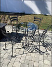 Cast Iron table with glass top with 4 chairs