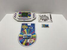 Wheel Of Fortune 1995 Tiger Handheld Electronic Game Plus 2 Cartridges & Manual