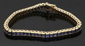 Heavy 14K gold amazing 11.0CTW tanzanite line link bracelet