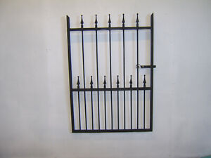 4 ft tall wrought iron  garden / side gate very strong hangs on the left !
