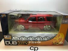 JADA DUB CITY 2002 CADILLAC ESCALADE 1:18 RED WITH EXTRA WHEELS