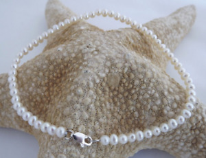 2-3 mm circular white pearl necklace 18 inches silver clasp Mesmerizing