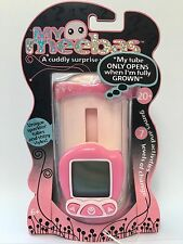 My Meebas Electronic Child's Game Sparkly Pink Tube New Sealed Play And Hatch