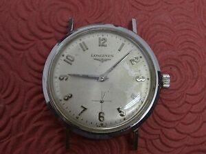 LONGINES VINTAGE STAINLESS STEEL MANUAL WIND MANS WRISTWATCH FOR THE COLLECTOR.