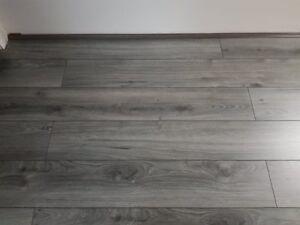 laminate flooring 7mm  grey  swiss krono      4 way v groove clic fit  + fitting