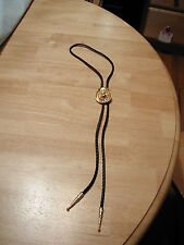 LADIES VINTAGE BOLO TIE WITH GOLTONE HAT AND RHINESTONES BLACK BRAIDED LEATHER