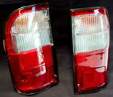 TOYOTA HILUX LN167 1998 - 2004 REAR TAIL BRAKE LIGHTS LAMPS PAIR 477