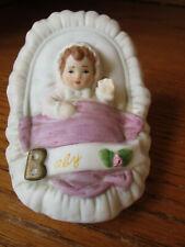 "Enesco Growing up Birthday Girl Porcelain Figurine Baby in Cradle 3"" Long 1987"