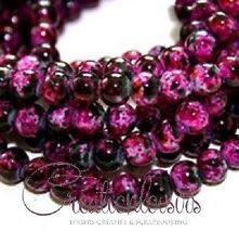 50 perles howlite en verre rose-fushia diamètre 4 mm - Couleur à effet tachetée