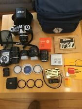 Nikon Fm 35mm Film Camera Outfit = 4 lenses, accessories and case