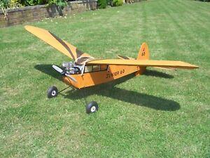 R.C. model Aircraft.Junior 60.OS max FP35 engine,3xHitec servos, 62in wingspan.