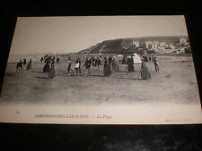 Old printed postcard people on the beach at Arromanches-les-bains  France c1900s