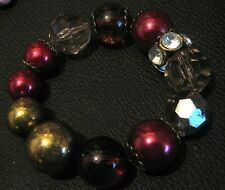 Great elasticated beaded bracelet with large various design beads