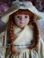 "Lovely artist made porcelain doll. Approx 21"" tall if standing. Sitting Doll."