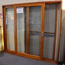 CEDAR SLIDING DOORS WITH FLY SCREEN, SOLID CEDAR TIMBER 2100W X 2100, OPENS L-R