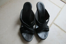 Cole Haan Black slip on open toe leather mules. Size 9.5m.Good condition.