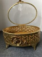 Vintage gold tone filigree design in this metal jewelry box with a Glass top.
