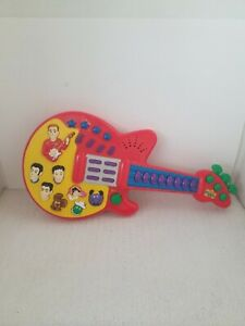 2003 THE WIGGLES Red Play Along Musical Guitar Batteries Included