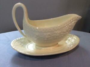 Wedgwood Wellesley creamware gravy boat with attached underplate