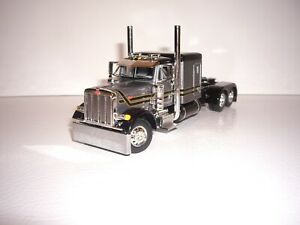 DCP FIRST GEAR 1/64 GRAY WITH BLACK STRIPES PETERBILT 379 WITH 63'' SLEEPER
