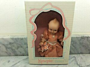 """Kewpie 7.5"""" Vinyl Doll In pink dress Outfit By Jesco"""
