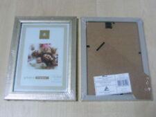 Portafotos y marcos decorativos en plateado de madera para el hogar