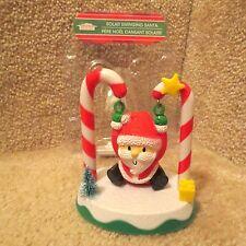 Solar Swinging Santa on Candy Canes