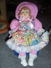 "Vintage Ceramic Musical Windup 12"" Baby Girl Doll. Blue Eyes.Pink Cap/Dress 85"